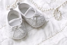 Jaki prezent na chrzest? 12 pomysłów na prezent od chrzestnego i chrzestnej